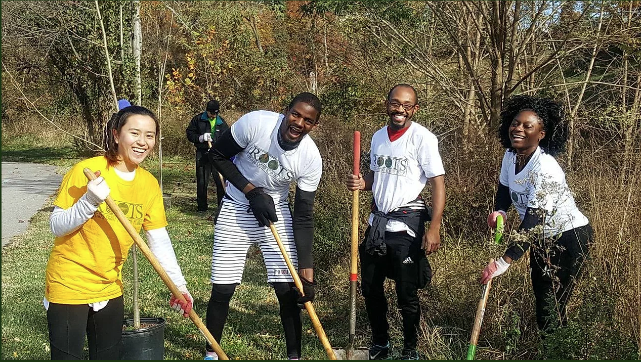 Roots Africa Team Raking Leaves